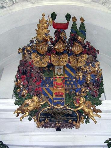 Jost Schutzes träsniderier i Spånga kyrka. Bondes huvudbaner. Foto: Vladimir Sagerlund