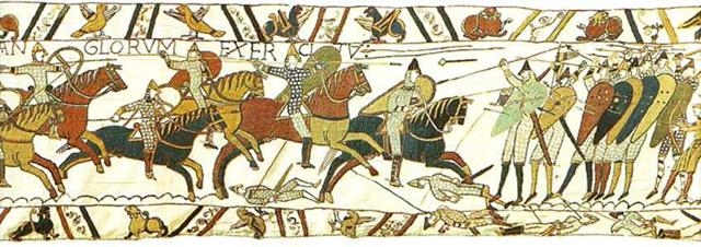Scen ut Bayeux-tapeten som visar en rad proto-heraldiska sköldar.