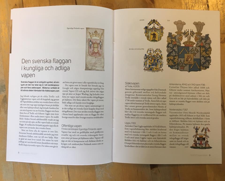 Bild på ett uppslag i tidningen Vapenbilden som visar svenska flaggor
